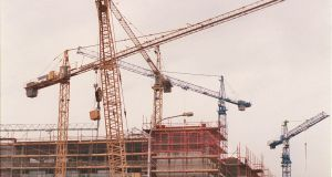 Building boom: cranes towering over a construction site on the Dublin quays. Photograph: Alan Betson