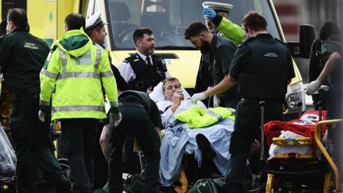 Members of the public are treated by emergency services near Westminster Bridge and the Houses of Parliament in London. At least one person has reportedly died in the 'terrorist attack'. Photograph: Carl Court/Getty Images