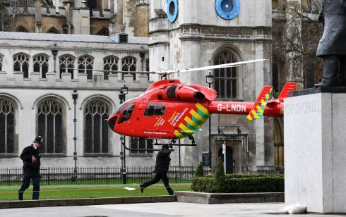 An air ambulance on Parliament Square following a major incident outside the Houses of Parliament in central London. One woman has died following the 'terrorist incident'. Photograph: Andy Rain/EPA