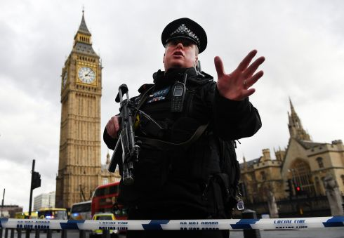Armed police push people back following major incidents outside the Houses of Parliament in central London. Photograph: Andy Rain/EPA