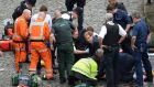 Cabinet minister Tobias Ellwood (centre) helps emergency services attend to a police officer  after the officer was stabbed in a terrorist attack outside Westminster. Photograph: Stefan Rousseau/PA Wire