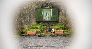 An altar at the babies burial ground in Tuam, Co Galway,  seen from  behind construction hoarding. Photograph: Barry Cronin