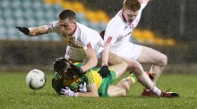 Donegal's Michael Carroll with Tyrone's Paul Donaghey and Nathan Donnelly. Photo: Inpho