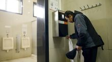 Beijing bathroom users are finding themselves on the hot seat over hoarding loo roll. Photograph: Wang Zhao/AFP/Getty Images
