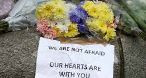 Flowers and messages are left near the scene of an attack by a man driving a car and weilding a knife left five people dead and dozens injured, in London. REUTERS/Neil Hall