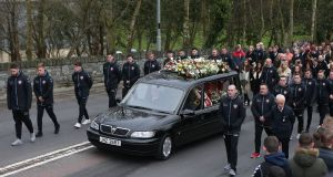 The funeral cortege of Derry City  captain Ryan McBride travels to the Long Tower church in Derry on Thursday. Photograph: Niall Carson/PA Wire.