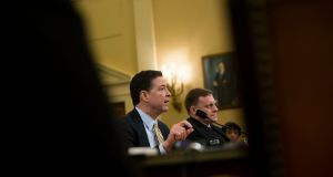 FBI director James Comey and  Michael Rogers, director of the NSA:  Comey said that a tweet put out by the president's account, interpreting what he said, was not accurate. Photograph: Eric Thayer/The New York Times