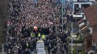 Mourners form a funeral procession as they make their way with Martin McGuinness' coffin to St Columba's Church Long Tower. Photograph: AFP/Getty Images