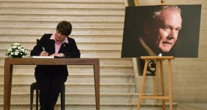 DUP leader Arlene Foster signs a book of condolence for her late former colleague Martin McGuinness at Stormont on Wednesday. Photograph: Ben Stansall/AFP/Getty Images