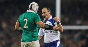 South African referee Jaco Peyper talks to Ireland captain Rory Best during the game against New Zealand at the Aviva Stadium last November. Photograph: Billy Stickland/Inpho