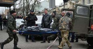 The body of Denis Voronenkov is carried away by forensic experts in downtown Kiev on Thursday. Mr Voronenkov appeared to be a loyal pro-Kremlin deputy in Russia's parliament until he was accused of fraud and fled to Ukraine last October. Photograph:  Andrew Kravchenko/EPA