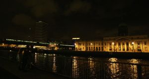 What a turnoff: A dimly visible Liberty Hall with its lights out during Earth Hour 2008. Photograph: Aidan Crawley