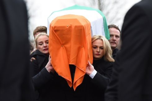 Daughters Fionnuala McGuinness and Grainne McGuinness carry the coffin of their father, the late Martin McGuinness to the funeral service at St Columba's Church.  Photograph: Charles McQuillan/Getty Images