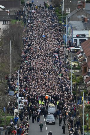 Mourners form a funeral procession as they make their way with the coffin to St Columba's Church Long Tower for the funeral of former Northern Ireland deputy first minister Martin McGuinness in Derry. Photograph: Ben Stansall/AFP