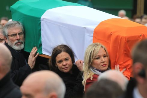 Sinn Fein president Gerry Adams, along with deputy leader Mary Lou McDonald and Northern leader Michelle O'Neill carry the coffin. Photograph: Paul McErlane/ EPA