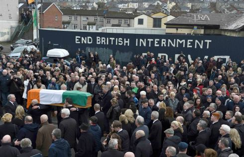 The coffin of Martin McGuinness is carried through crowded streets during his funeral.  Photograph: Clodagh Kilcoyne / Reuters