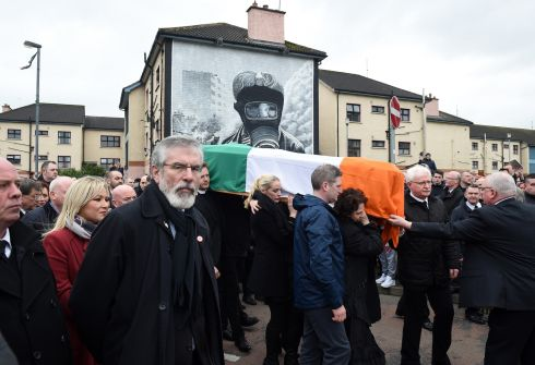 Sinn Fein President Gerry Adams looks on as the funeral cortege passes Free Derry Corner.  Photograph: Charles McQuillan/Getty Images