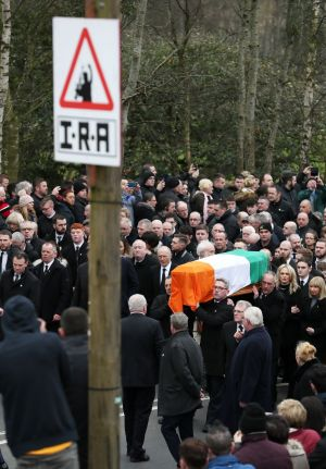 The coffin of Northern Ireland's former deputy first minister and ex-IRA commander Martin McGuinness is carried up Barrack Street. Photograph: Brian Lawless/PA