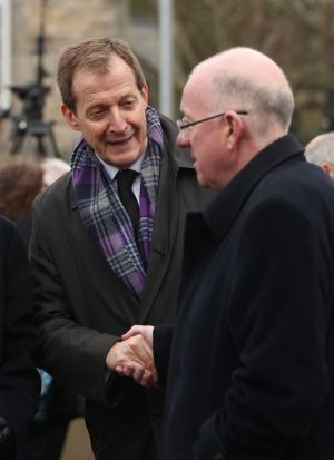 Minister for Foreign Affairs Charlie Flanagan shakes hands with Alastair Campbell as they arrive for the funeral.  Photograph: Niall Carson/PA