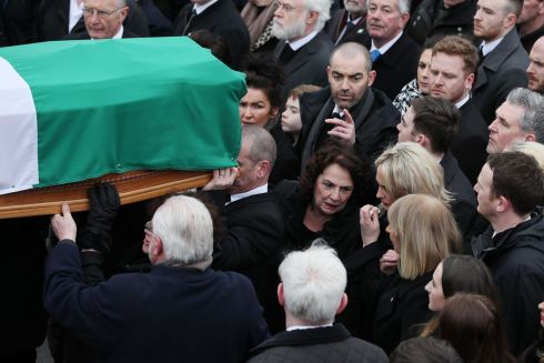 Martin McGuinness's wife Bernie (centre) follows his coffin is it arrives at St Columba's Church Long Tower, in Derry.  Photograph: Brian Lawless/PA