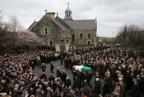 The coffin is carried up Barrack Street to St Columba's Church Long Tower  Photograph: Brian Lawless/PA Wire