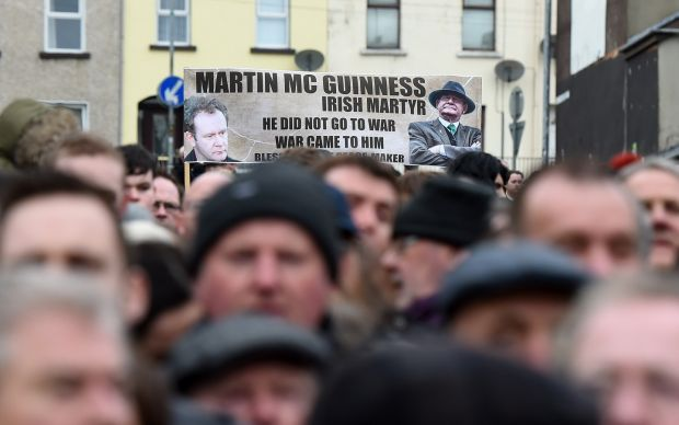 Mourners hold a banner for the late Martin McGuinness as they make their way to the funeral. Photograph: Charles McQuillan/Getty Images