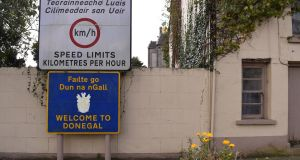 A Border sign in Pettigo, Co Donegal: a shared-space arrangement would enable a shared civil and commercial life, while preserving  current political identities. Photograph: Clodagh Kilcoyne/Reuters