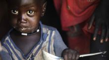 A boy eats  at his home in Ngop in South Sudan's Unity State: Famine was declared in parts of South Sudan on February 29th. Photograph: Albert Gonzalez Farran/AFP/Getty