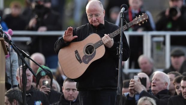 Singer-songwriter Christy Moore performs a tribute to Martin McGuinness at Derry's City Cemetery. Photograph: Charles McQuillan/Getty Images