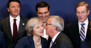 European Commission President Jean-Claude Juncker kisses Britain's Prime Minister Theresa May
