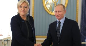 Russian president Vladimir Putin with French presidential election candidate and  Front National party leader Marine Le Pen at the Kremlin in Moscow on Friday. Photograph: Mikhail Klimentyev/AFP/Getty Images