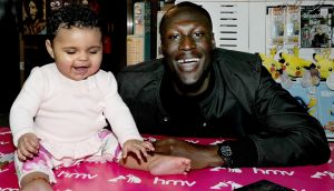 Stormzy meets infant fans and signs copies of his new album 'Gang Signs And Prayer' at HMV Liverpool One on March 2, 2017. (Photograph: Shirlaine Forrest/WireImage