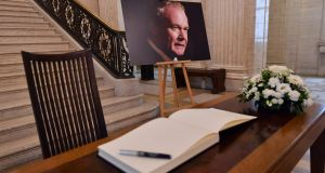 Realistic rejection of violence: an image of Martin McGuinness next  to a book of condolences   at Stormont this week. Photograph: Ben Stansall/AFP/Getty Images