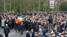 The  coffin of Martin McGuinness is carried through  Derry at his funeral on Thursday. Photograph: Alan Betson