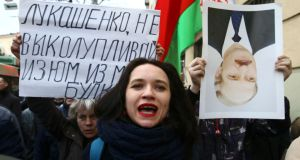 "People  protest against increased tariffs for communal services and new taxes in Minsk, Belarus, on March 15th. The placard , referring to the country's president, reads: ""Lukashenko, stop picking the raisins out of the bread"". Photograph: Vasily Fedosenko/Reuters"