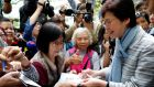 Carrie Lam signs autographs during  campaigning in Hong Kong this week. Photograph: Tyrone Siu/Reuters