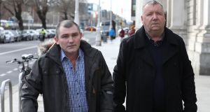 John Breen and George Davis leave the Four Courts after the  Circuit Civil Court action. Photograph: Collins Courts