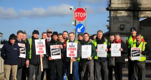 Bus Éireann staff picketing outside the Broadstone Bus Éireann depot, in Dublin, on Friday. Photograph: Gareth Chaney Collins