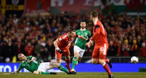 Wales' Gareth Bale is tackled by the Republic of Ireland's James McClean. Photograph: Clodagh Kilcoyne/Reuters