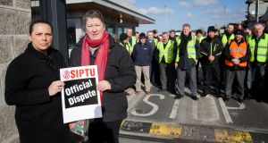 Bus Éireann workers Leona White (left) from Finglas and Ailish Delaney from Clonsilla picketing outside the Broadstone bus  depot in  Dublin as part of an indefinite all-out strike over the company's implementation of cost-reduction measures without union agreement. Photograph: Gareth Chaney/Collins