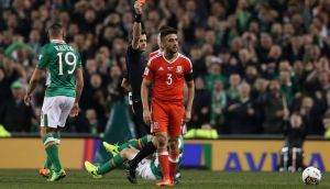 Neil Taylor is shown a straight red for his challenge on Séamus Coleman. Photograph: Brian Lawless/PA