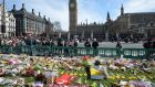 Floral tributes   in Parliament Square, London, for the victims of the Westminster terror attack. Photograph: John Stillwell/PA Wire