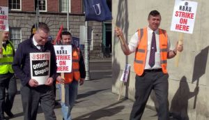 Striking Bus Éireann workers outside Busaras in Dublin on Saturday. Photograph: Bryan O'Brien/The Irish Times