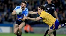 Dublin's Eric Lowndes is tackled by  David Murray of Roscommon during the Allianz League Division One game at Croke Park. Photograph: Donall Farmer/Inpho