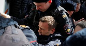 Police  detain anti-corruption campaigner and opposition leader Alexei Navalny at a rally in Moscow on Sunday. Photograph: Maxim Shemetov/Reuters