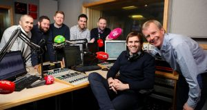 """Off the Ball"" presenters, with sports editor Adrian Barry (third from left)  and Eir's group sponsorship manager John Anslow (right). Photograph: Maxwells"