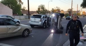 A self-driving  Volvo SUV owned and operated by Uber  is flipped on its side after a collision in  Arizona