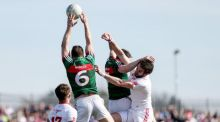 Lee Keegan rises highest to win the ball ahead of Ronan McNamee during Mayo's one-point win over Tyrone. Photograph: Matt Mackey/Inpho