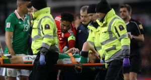 Republic of Ireland's Seamus Coleman is stretchered off the pitch during the  World Cup qualifier against Wales. Photograph: Niall Carson/PA Wire