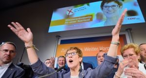 Annegret Kramp-Karrenbauer, lead candidate of the German Christian Democrats (CDU), celebrates   after the initial election result  in Saarland, Germany. Photograph: Thomas Lohnes/Getty